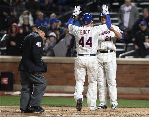 New York Mets' John Buck (44) is congratulated by Lucas Duda after hitting a two-run home run in the fourth inning of a baseball game against the San Diego Padres on Wednesday, April 3, 2013, in New York. At left is umpire Jerry Meals. (AP Photo/Peter Morgan)