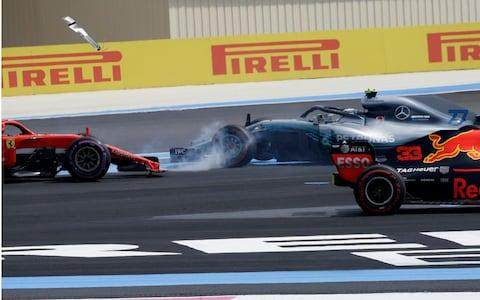 Bottas and Vettel collide - Credit: AP