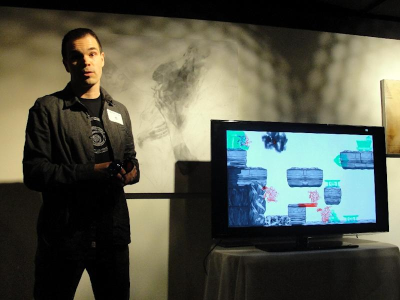 "Ubisoft senior producer Mathieu Ferland shows off a ""Dig Rush"" video game seeking approval from US regulators to be used as a prescribed medical treatment for an eye condition effecting millions of people on March 2, 2015 in San Francisco, California"