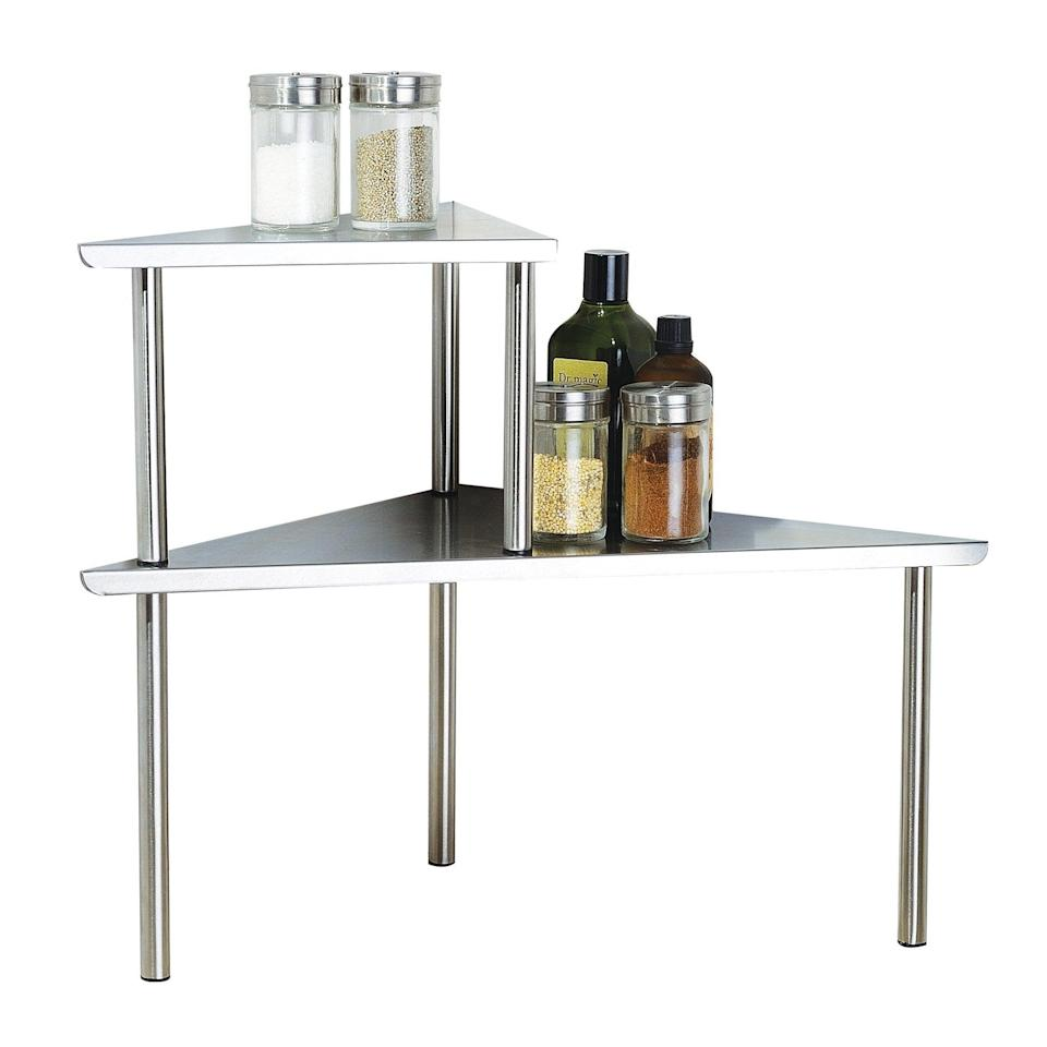 "<h3><a href=""https://amzn.to/392dXH0"" rel=""nofollow noopener"" target=""_blank"" data-ylk=""slk:Cook N Home 2-Tier Corner Organizer"" class=""link rapid-noclick-resp"">Cook N Home 2-Tier Corner Organizer</a></h3> <br>Another very useful purchase that isn't much in the way of fun, these shelves make storage space out of the corner of your countertop (aka a usually dead space).<br><br><br><br><br><strong>Cook N Home</strong> Cook N Home 2-Tier Stainless Steel Corner Storage Shelf Organizer, Triangle, Triangle Stainless Steel, $, available at <a href=""https://amzn.to/3euB6mk"" rel=""nofollow noopener"" target=""_blank"" data-ylk=""slk:Amazon"" class=""link rapid-noclick-resp"">Amazon</a><br><br><br><br>"