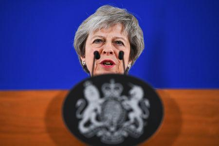 Britain's Prime Minister Theresa May attends a news conference in Brussels, Belgium November 25, 2018. REUTERS/Dylan Martinez/Files