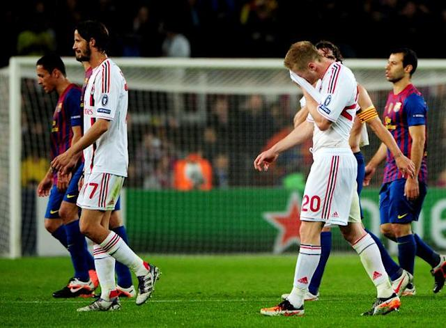 AC Milan's midfielder Ignazio Abate (R) and AC Milan's defender Luca Antonini react at the end of the Champions League quarter-final second leg football match FC Barcelona vs AC Milan on April 3, 2012 at Camp Nou stadium in Barcelona. FC Barcelona defeated AC Milan 3-1 to reach the semi-finals. AFP PHOTO / OLIVIER MORIN