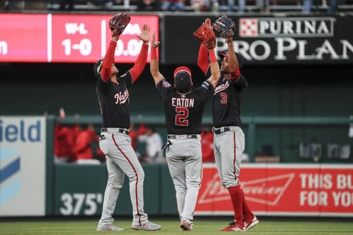 Washington Nationals' Juan Soto (22), Adam Eaton (2) and Michael A. Taylor (3) celebrate after Game 2 of the baseball National League Championship Series against the St. Louis Cardinals Saturday, Oct. 12, 2019, in St. Louis. The Nationals won 3-1 to take a 2-0 lead in the series. (AP Photo/Jeff Roberson)
