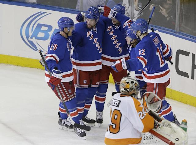 Philadelphia Flyers goalie Ray Emery (29) reacts as the New York Rangers celebrate a goal by Rangers' Carl Hagelin during the third period in Game 1 of an NHL hockey first-round playoff series on Thursday, April 17, 2014, in New York. The Rangers won the game 4-1. (AP Photo/Frank Franklin II)
