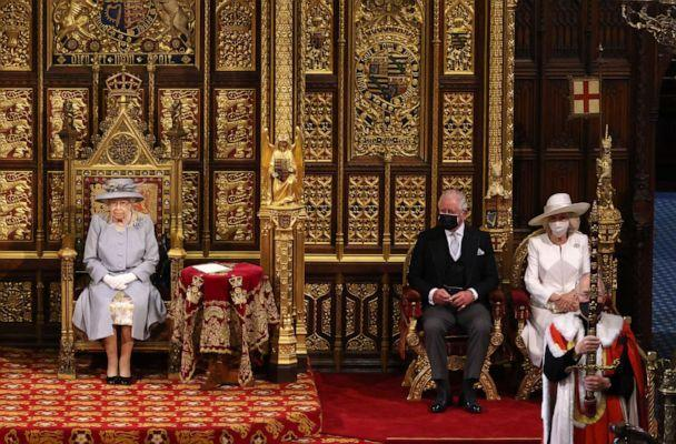 PHOTO: Queen Elizabeth II sits in the House of Lord's Chamber with Prince Charles, Prince of Wales and Camilla, Duchess of Cornwall seated at right during the State Opening of Parliament at the House of Lords on May 11, 2021, in London. (Chris Jackson/Getty Images)