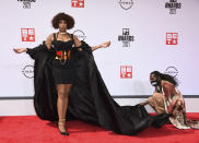 An assistant helps with Jennifer Hudson's outfit as she poses at the BET Awards on Sunday, June 27, 2021, at the Microsoft Theater in Los Angeles. (Photo by Jordan Strauss/Invision/AP)