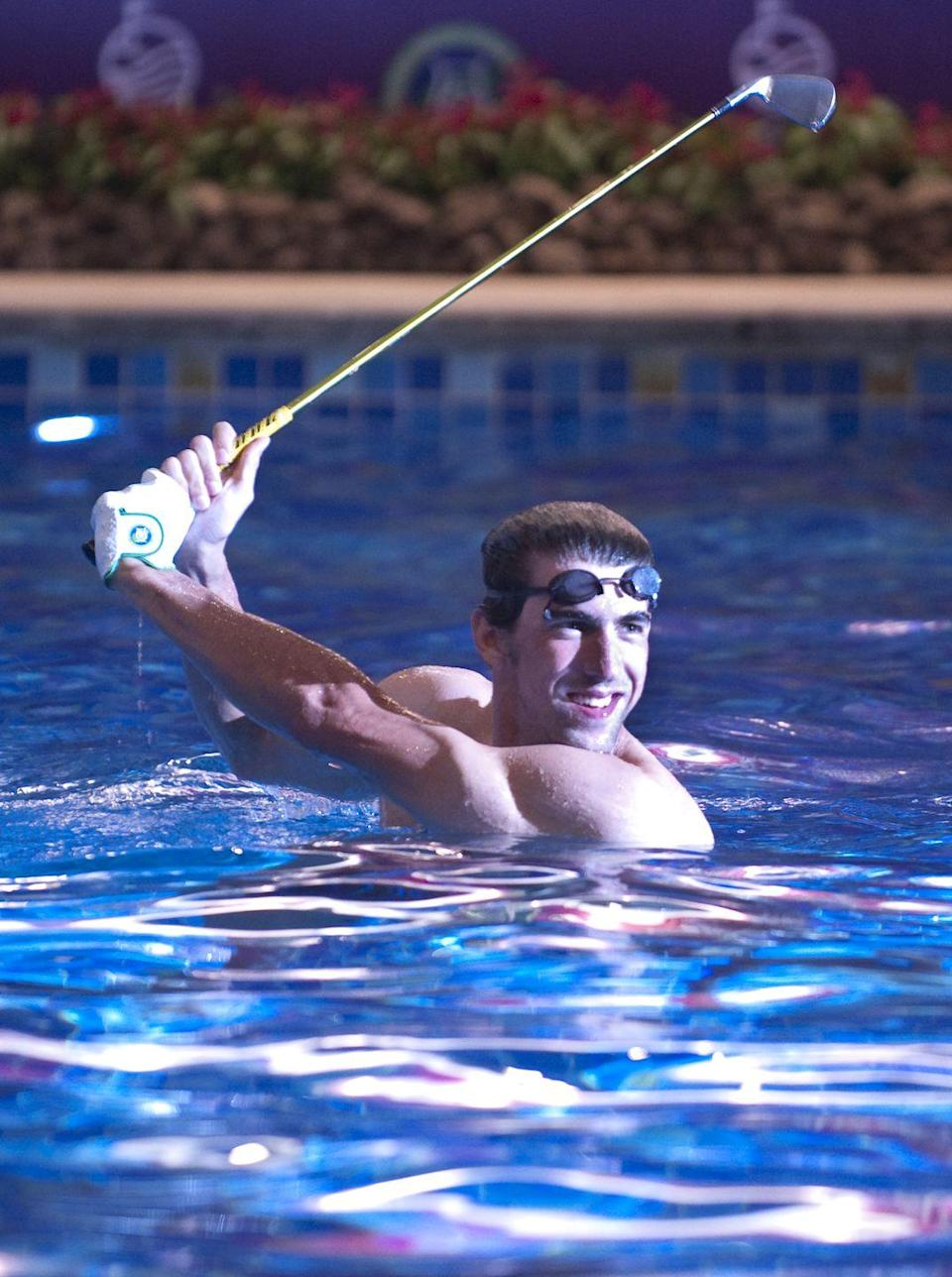 <p>Michael Phelps poses for the media at promotional event during day four of the Mission Hills Start Trophy tournament at Mission Hills Resort in October 2010.</p>