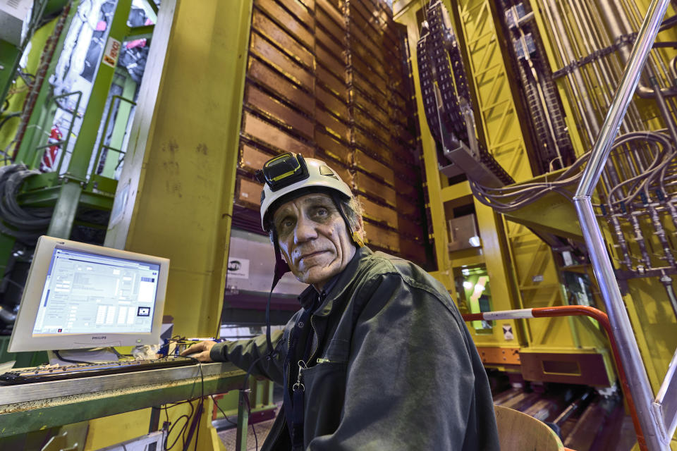 In this 2018 photo made available by CERN, Nikolai Bondar works on the LHCb Muon system at the European Organization for Nuclear Research Large Hadron Collider facility outside of Geneva. Preliminary results published in 2021 of experiments from here and the Fermilab facility in the U.S. challenge the way physicists think the universe works, a prospect that has the field of particle physics both baffled and thrilled. (Maximilien Brice, Julien Marius Ordan/CERN via AP)