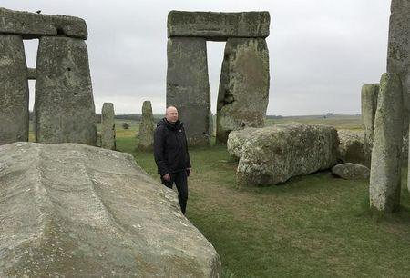 Doctor Rupert Till, music technologist from the University of Huddersfield, poses for a photograph in the stone circle of the ancient monument of Stonehenge, Amesbury, Britain February 22, 2017.  REUTERS/Matthew Stock/File Photo
