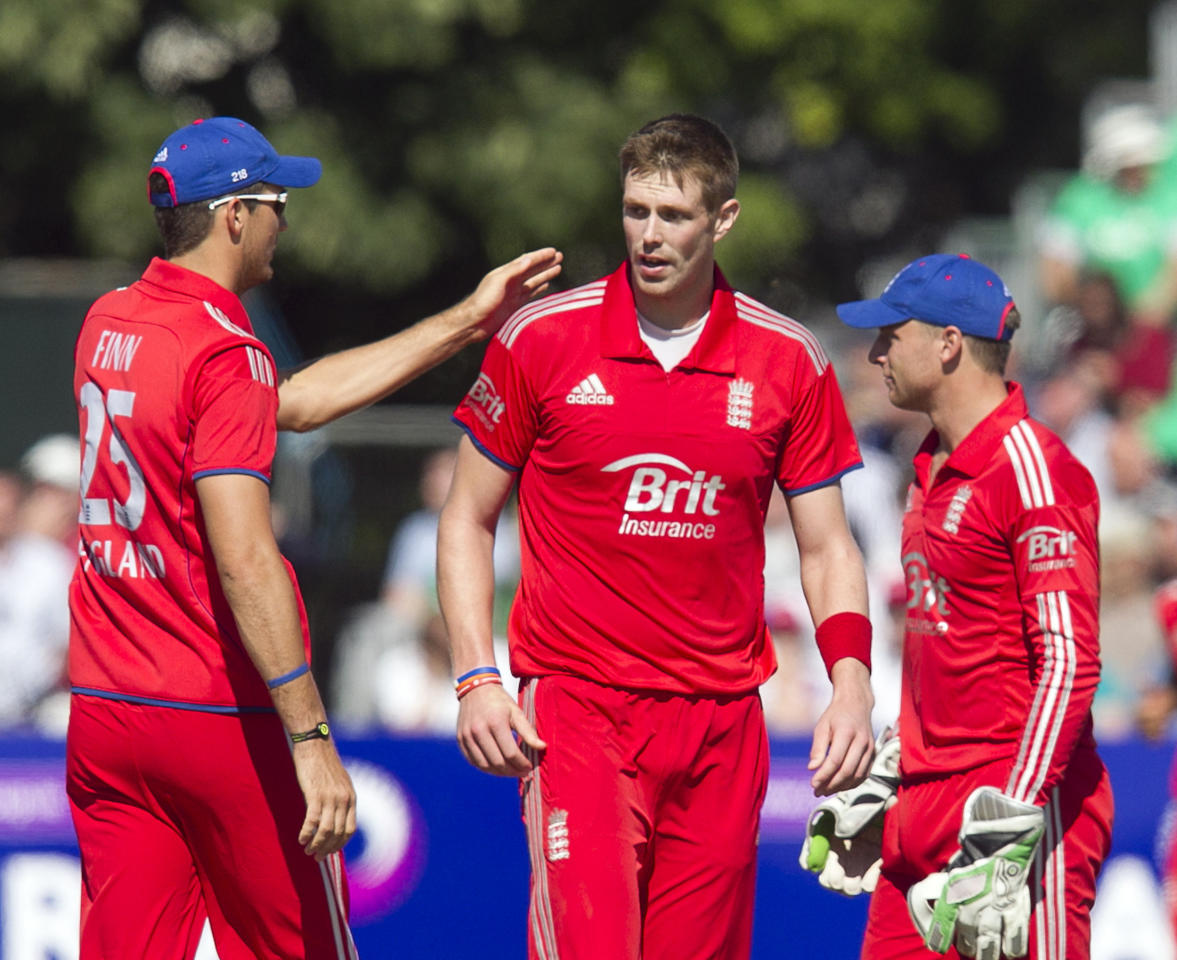 England's Boyd Rankin (centre) is congratulated by Steven Finn (left) and wicket keeper Jos Buttler (right) after bowling Ireland's John Mooney (not pictured) during the One Day International at The Village, Dublin.