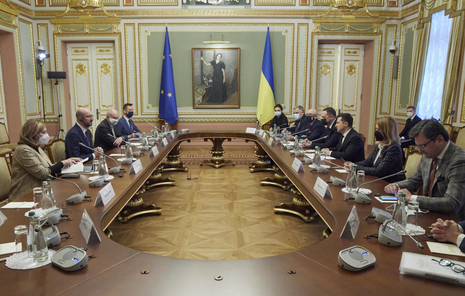 In this photo provided by the Ukrainian Presidential Press Office, Ukrainian President Volodymyr Zelenskiy, center right, and European Council President Charles Michel during their meeting in Kyiv, Ukraine, Wednesday, March 3, 2021. (Ukrainian Presidential Press Office via AP)