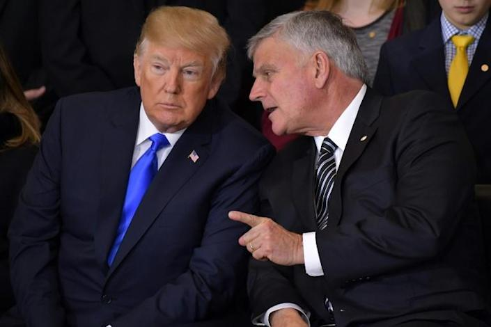 """Franklin Graham (right), son of the celebrated late pastor Billy Graham, has supported Trump even as the magazine his father founded """"Christianity Today"""" called for the president's removal (AFP Photo/Mandel NGAN)"""