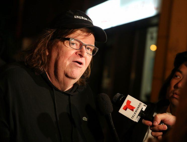 Director Michael Moore speaks to the media at the premiere of his documentary