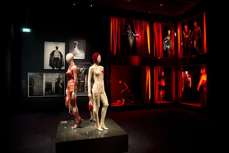 """Mannequins inspired by the red light district are seen in the exhibit of French fashion designer Jean Paul Gaultier called """"The Fashion World of Jean Paul Gaultier, from the sidewalk to the catwalk"""", at Kunsthal museum in Rotterdam, Netherlands, Friday Feb. 8, 2013. The exhibit opens to the public on Feb. 10, 2013. (AP Photo/Peter Dejong)"""