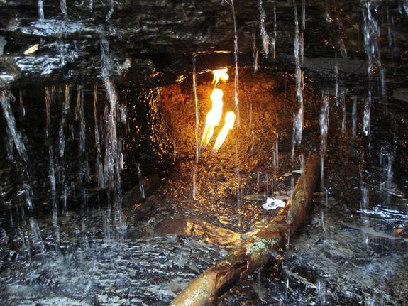 A gas-fired flame shines through a waterfall at Chestnut Ridge Park in Erie County, N.Y.
