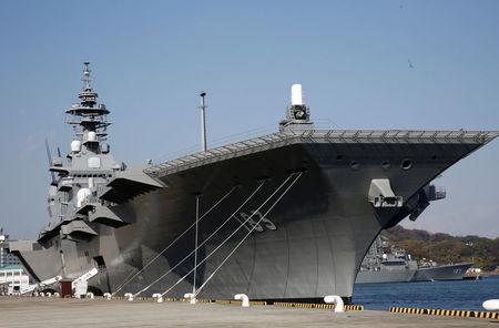 FILE PHOTO: Japan Maritime Self Defense Force's helicopter carrier Izumo is seen at JMSDF Yokosuka base in Yokosuka, south of Tokyo, Japan, December 6, 2016. REUTERS/Kim Kyung-Hoon/File Photo