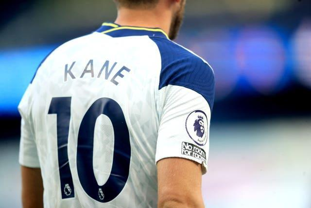 """A general view of the """"No room for racism"""" badge on Tottenham forward Harry Kane"""