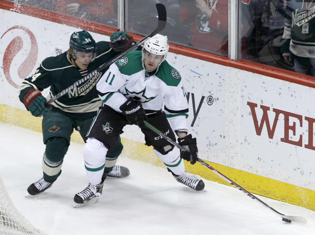 Dallas Stars center Dustin Jeffrey (11) controls the puck in front of Minnesota Wild center Mikael Granlund, left, of Finland, during the first period of an NHL hockey game in St. Paul, Minn., Saturday, Jan. 18, 2014. (AP Photo/Ann Heisenfelt)