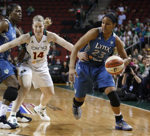 Minnesota Lynx's Taj McWilliams-Franklin, left, and Maya Moore, right, work against Seattle Storm's Katie Smith during the first half of Game 2 of a WNBA basketball first-round playoff series, Sunday, Sept. 30, 2012, in Seattle. (AP Photo/Kevin P. Casey)