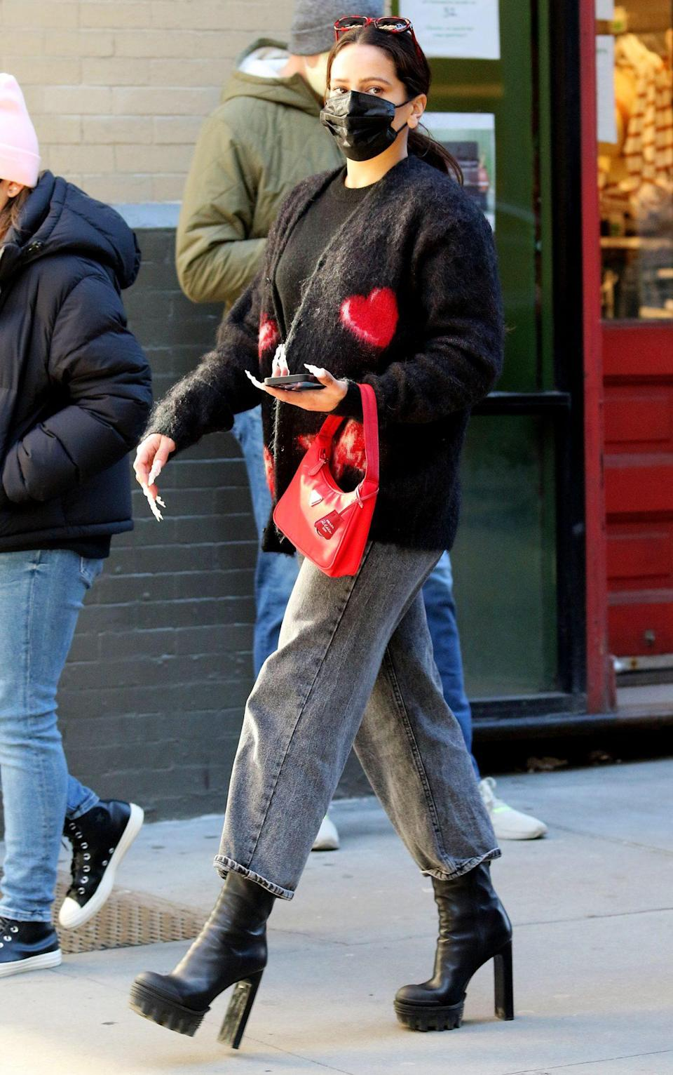 <p>Rosalía heads to eat pizza in N.Y.C.'s Soho area on Sunday, wearing a black sweater and sky-high black boots.</p>