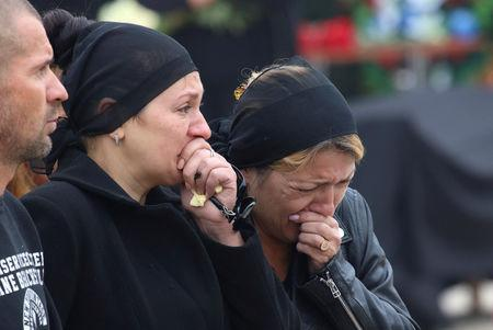 People mourn during a memorial ceremony before the funeral of victims of an attack on a local college in the city of Kerch, Crimea October 19, 2018. REUTERS/Pavel Rebrov