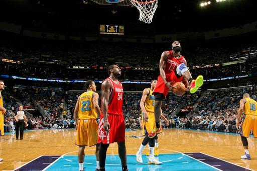 NEW ORLEANS, LA - JANUARY 25: James Harden #13 of the Houston Rockets crosses the ball between his legs while driving to the basket after play was stopped against the New Orleans Hornets on January 25, 2013 at the New Orleans Arena in New Orleans, Louisiana. (Photo by Layne Murdoch/NBAE via Getty Images)