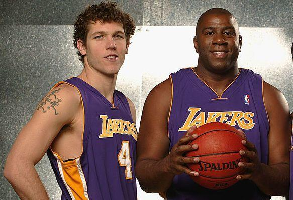 Lakers coach Luke Walton and team president Magic Johnson may not be on the same side for long. (Getty Images)