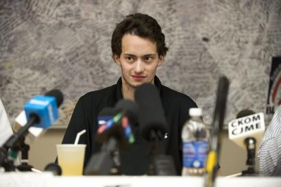 Kootenay Ice forward and Montreal Canadiens prospect Tim Bozon speaks to media regarding his expected release from a Saskatoon hospital after falling ill with meningitis at the beginning of March, in Saskatoon, Saskatchewan, on Friday, March 28, 2014. (AP Photo/The Canadian Press, Liam Richards)