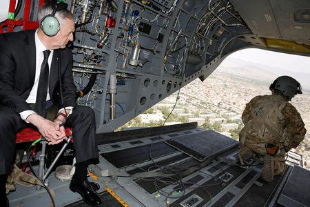 Mattis looks out over Kabul as he arrives via helicopter at Resolute Support headquarters in Kabul