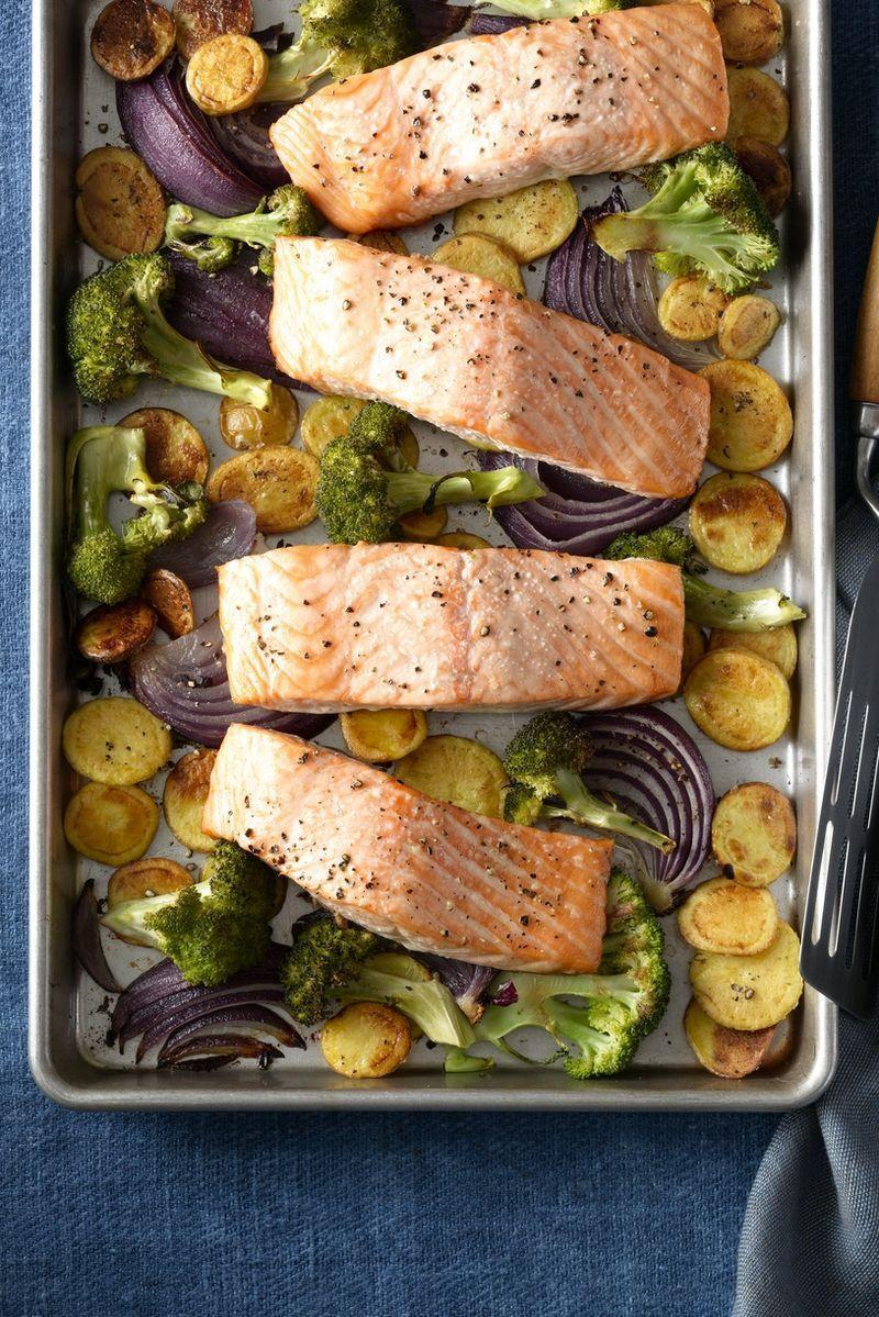 """<p>This tender, juicy salmon with the crispy potatoes and broccoli are sure to please.</p><p><a href=""""https://www.womansday.com/food-recipes/food-drinks/recipes/a12427/roasted-salmon-crispy-potatoes-broccoli-recipe-wdy0115/"""" rel=""""nofollow noopener"""" target=""""_blank"""" data-ylk=""""slk:Get the recipe for Roasted Salmon with Crispy Potatoes and Broccoli."""" class=""""link rapid-noclick-resp""""><em>Get the recipe for Roasted Salmon with Crispy Potatoes and Broccoli.</em></a></p>"""