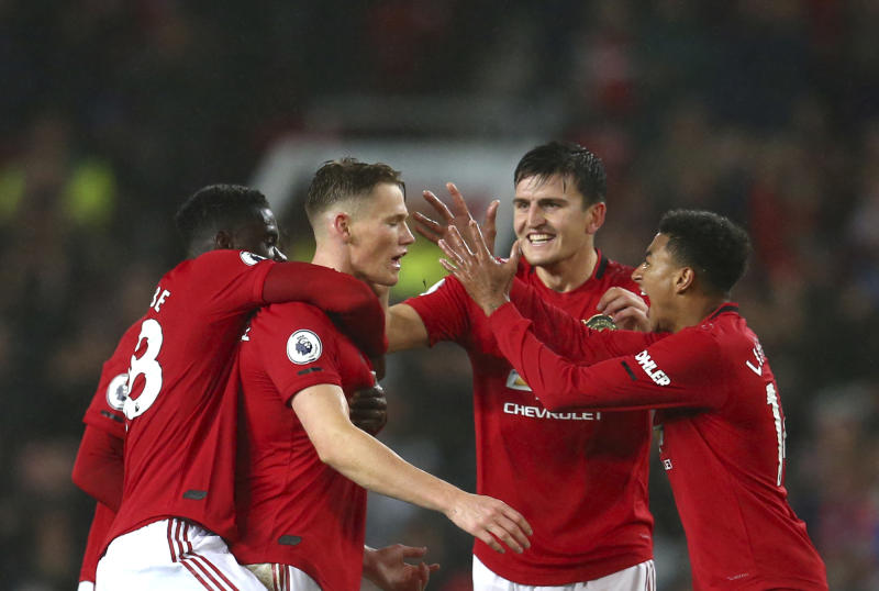 Manchester United players celebrate after Manchester United's Scott McTominay, centre, scored his side's opening goal during the English Premier League soccer match between Manchester United and Arsenal at Old Trafford in Manchester, England, Monday, Sept. 30, 2019. (AP Photo/Dave Thompson)