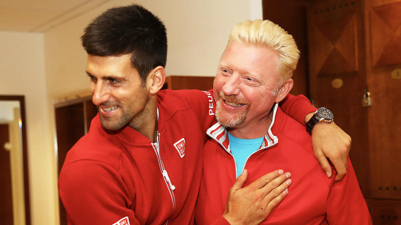 Boris Becker (pictured right) celebrating and sharing a hug with Novak Djokovic (pictured left).