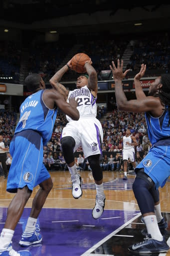SACRAMENTO, CA - APRIL 5: Isaiah Thomas #22 of the Sacramento Kings shoots the ball against Darren Collison #4 of the Dallas Mavericks on April 5, 2013 at Sleep Train Arena in Sacramento, California. (Photo by Rocky Widner/NBAE via Getty Images)
