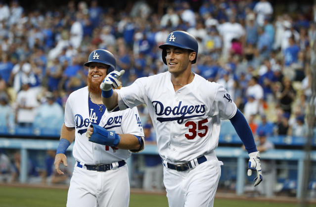 FILE - In this June 20, 2017, file photo, Los Angeles Dodgers' Cody Bellinger, right, and Justin Turner celebrate Bellinger's two-run home run during the first inning of a baseball game against the New York Mets,in Los Angeles. The Dodgers already have overcome the losses of injured veterans Adrian Gonzalez and Andre Ethier, along with Andrew Toles, thanks to the offensive prowess of Turner and NL rookie of the year candidate Cody Bellinger. (AP Photo/Jae C. Hong, File)