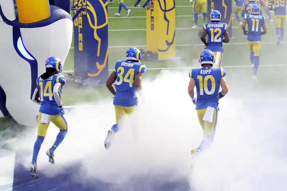 INGLEWOOD, CALIFORNIA - NOVEMBER 29: Nsimba Webster #14, Malcolm Brown #34 and Cooper Kupp #10 of the Los Angeles Rams run onto the field before the game against the San Francisco 49ers at SoFi Stadium on November 29, 2020 in Inglewood, California. (Photo by Katelyn Mulcahy/Getty Images)