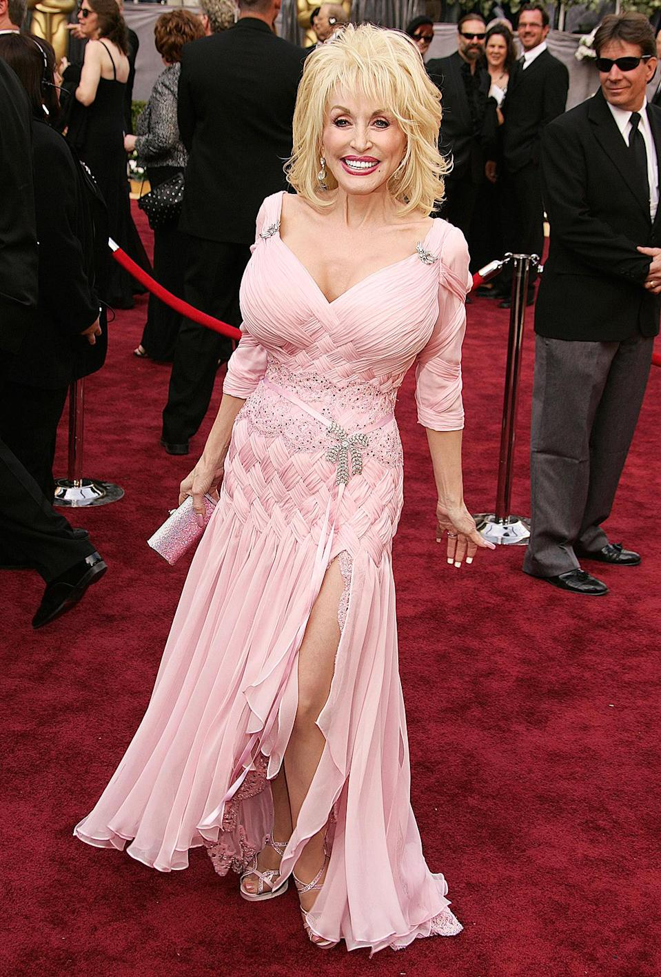 """<p>Ever since breaking through in 1967, Parton knows people may be looking — and judging — what she's wearing. But she's been the first to joke about her appearance. """"It costs a lot of money to look this cheap!"""" is one of her favorite quips. We'd argue she looked far from cheap at the 2006 Oscars, in a ruched gown with slit at the skirt. </p>"""