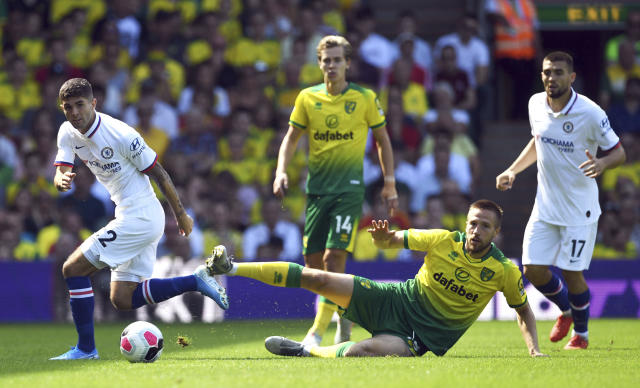 Chelsea's Christian Pulisic, left, and Norwich City's Marco Stiepermann battle for the ball during the English Premier League soccer match between Norwich City and Chelsea at the Carrow Road Stadium, Norwich, England. Saturday, Aug, 24 2019. (Joe Giddens/PA via AP)