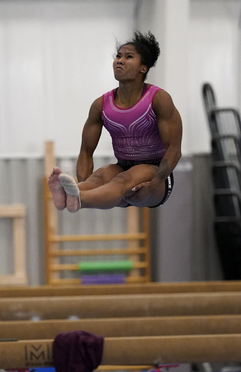 FIULE - In this May 11, 2021, file photo, gymnast Jordan Chiles practices her floor routine in Spring, Texas. Three years ago, Jordan Chiles wasn't sure she wanted to be a gymnast anymore. A move to Texas, a dash of maturity and a renewed confidence in herself have the 20-year-old on the cusp of earning a spot on the U.S. Olympic team. (AP Photo/David J. Phillip, File)