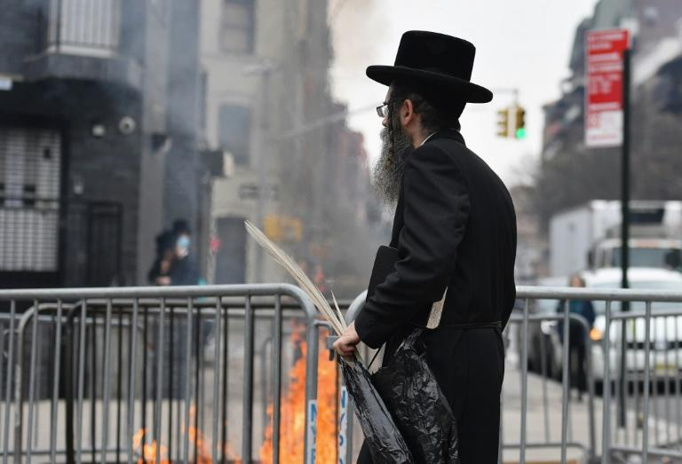 The scent of the traditional burning of chametz -- leavened products forbidden during the observant period -- wafted through the Hasidic zone of Crown Heights, the morning before Passover commenced
