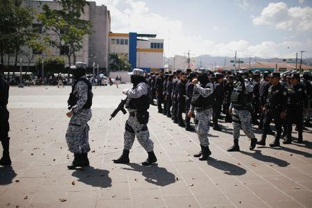 Salvadoran police officers prepare to be deployed before the presidential elections in downtown San Salvador, El Salvador February 2, 2019. REUTERS/Jose Cabezas