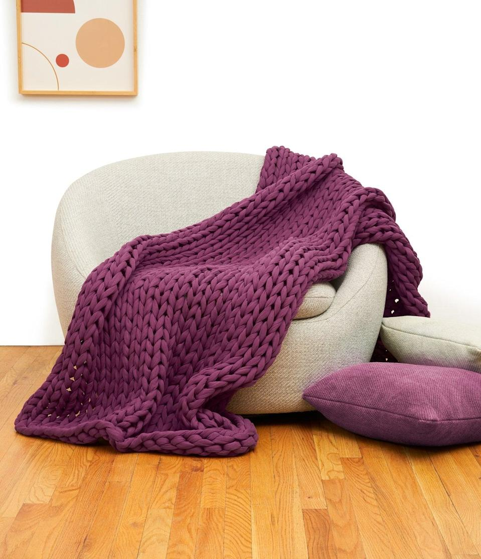 <p>Add some color to your living room with the <span>Bearaby Cotton Napper</span> ($249) in purple.</p>