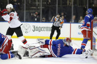 New Jersey Devils center Blake Coleman, left, celebrates as New York Rangers goaltender Igor Shesterkin (31) tries to retrieve the the puck on a goal by Coleman during the first period of an NHL hockey game, Thursday, Jan. 9, 2020, in New York. (AP Photo/Kathy Willens)