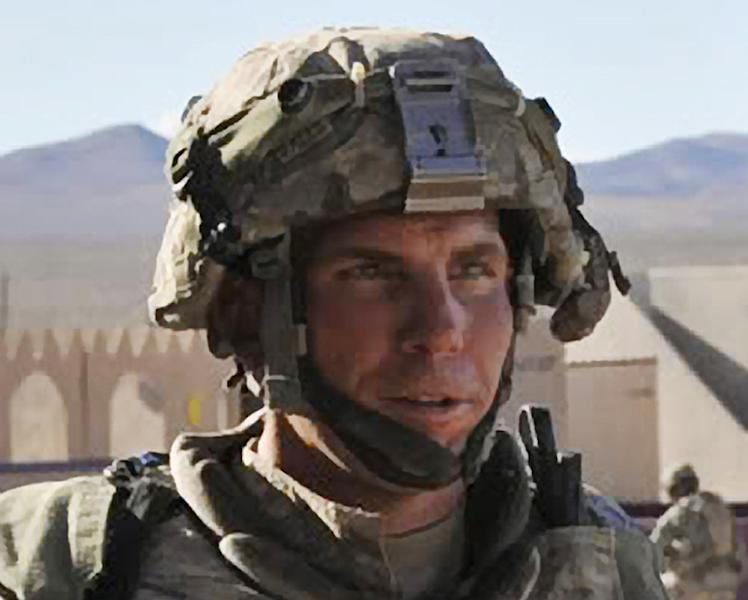 "FILE - In this Aug. 23, 2011 file photo provided by the Defense Video & Imagery Distribution System, Army Staff Sgt. Robert Bales participates in an exercise at the National Training Center at Fort Irwin, Calif. Kari Bales, the wife of Army Staff Sgt. Robert Bales, the soldier accused of killing 16 civilians in Afghanistan in March, told CBS ""This Morning"" on Monday, July 2, 2012 that she has not told their children why their father isn't coming home. Bales says she tells them he is at ""special work,"" and they think he'll be home soon. Bales says she believes her husband is innocent. (AP Photo/DVIDS, Spc. Ryan Hallock, File)"