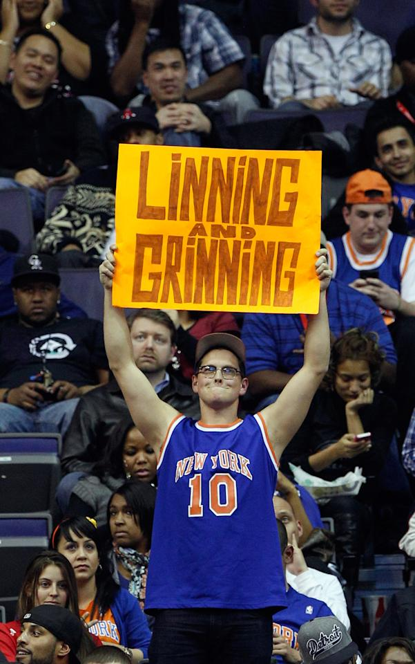 WASHINGTON, DC - FEBRUARY 08: A fan of Jeremy Lin #17 of the New York Knicks holds up a sign during the second half of the Knicks and Washington Wizards game at Verizon Center on February 8, 2012 in Washington, DC.  NOTE TO USER: User expressly acknowledges and agrees that, by downloading and or using this photograph, User is consenting to the terms and conditions of the Getty Images License Agreement. (Photo by Rob Carr/Getty Images)