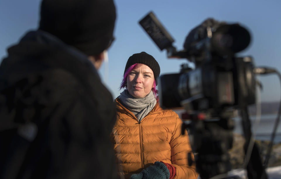 "Lisa Enroth is interviewed by the Associated Press, on the island of Hamneskar, western Sweden on Saturday, Jan. 30, 2021. The 44th Goteborg film festival opened this weekend in a mostly virtual format but an emergency ward nurse from Sweden was selected among 12,000 volunteers to spend a week on an isolated island in the North Sea with for only companionship the events' entire movie selection. Lisa Enroth said the opportunity gave her ""time to reflect"" after a busy year amid the COVID pandemic. (AP Photo/Thomas Johansson)"