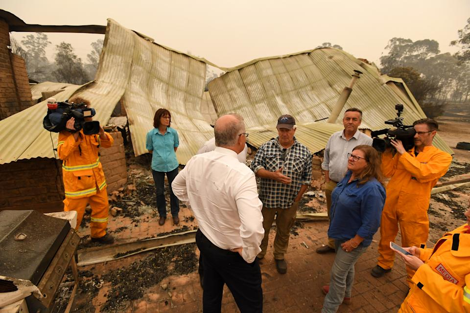 Pictured is Scott Morrison visiting a charred property in Sarsfield in Victoria.