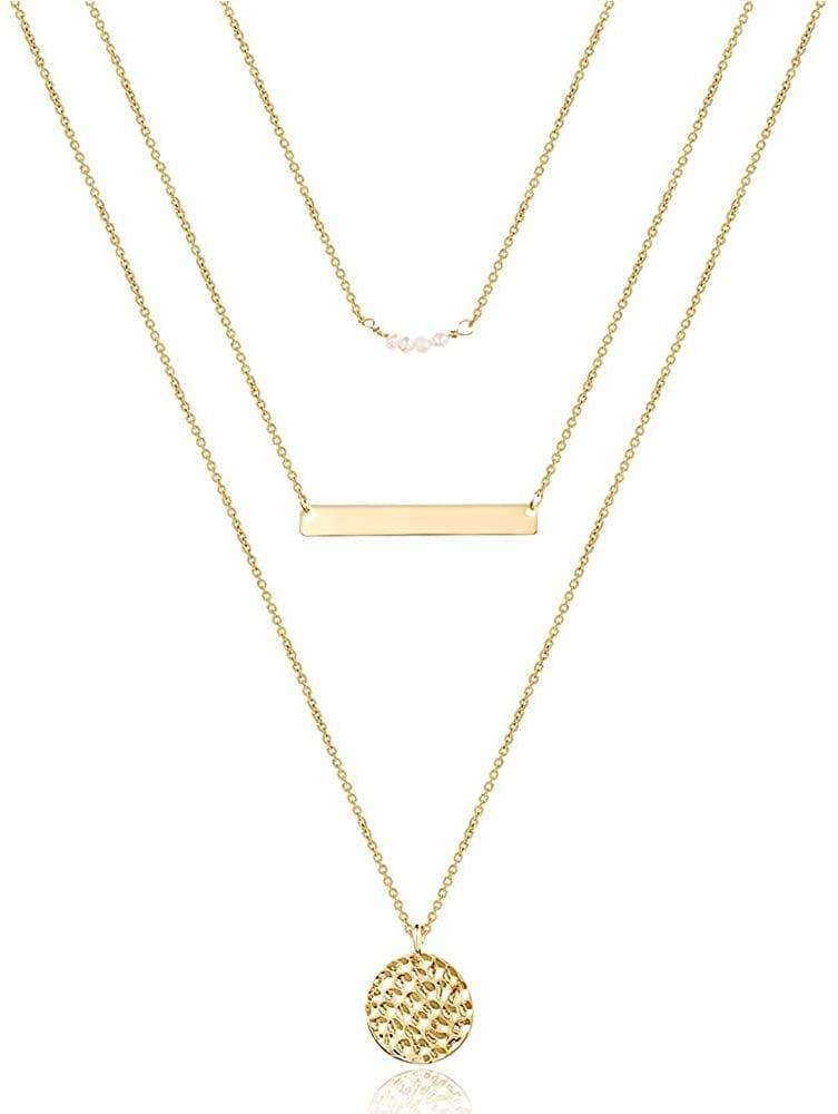 <p>Layer like a pro with the timeless gold-plated <span>Turandoss Dainty Simple Layering Necklaces </span> ($14). They come with a pearl necklace, a bar necklace, and a hammered disc pendant necklace.</p>