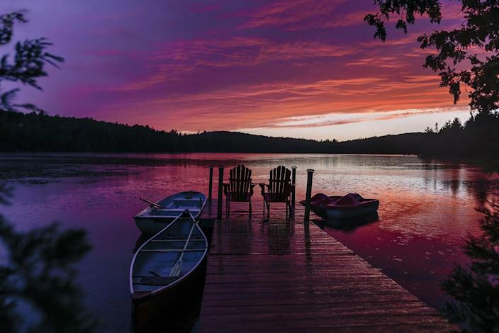<p>Night begins to fall on an idyllic summer setting at an undisclosed lake in Canada.</p>