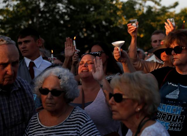 <p>People take part in a candlelight vigil near the Capital Gazette, the day after a gunman killed five people inside the newspaper's building in Annapolis, Md., June 29, 2018. (Photo: Leah Millis/Reuters) </p>