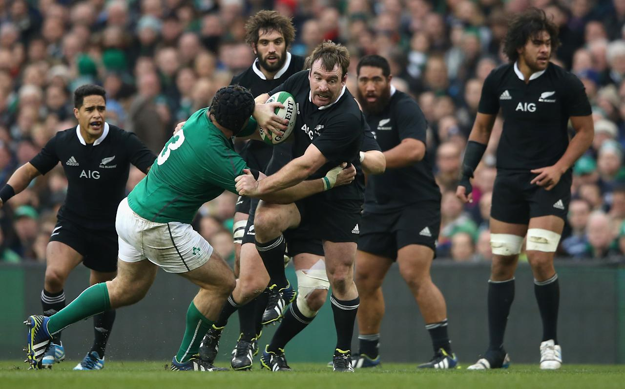 DUBLIN, IRELAND - NOVEMBER 24:  Andrew Hore of the All Blacks is tackled by Mike Ross during the International match between Ireland and New Zealand All Blacks at the Aviva Stadium on November 24, 2013 in Dublin, Ireland.  (Photo by David Rogers/Getty Images)